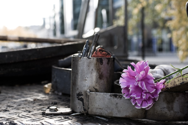 A flower lying on the back end of big loader found while walking around in Sollentuna.